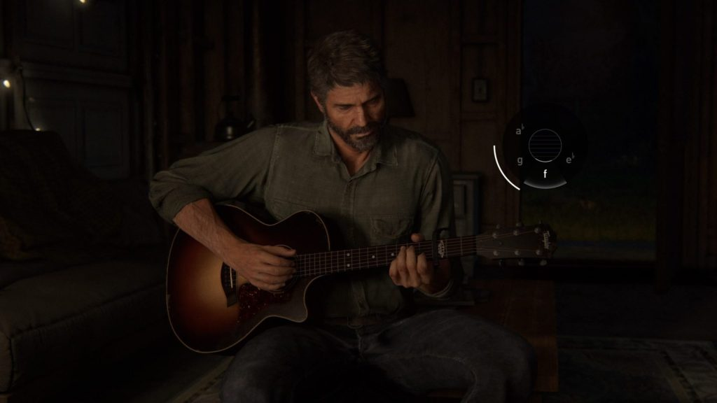 Joel holding a guitar, featuring the vibration.