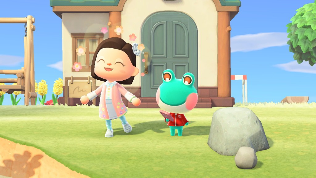 Animal Crossing, a girl being very happy next to a frog.
