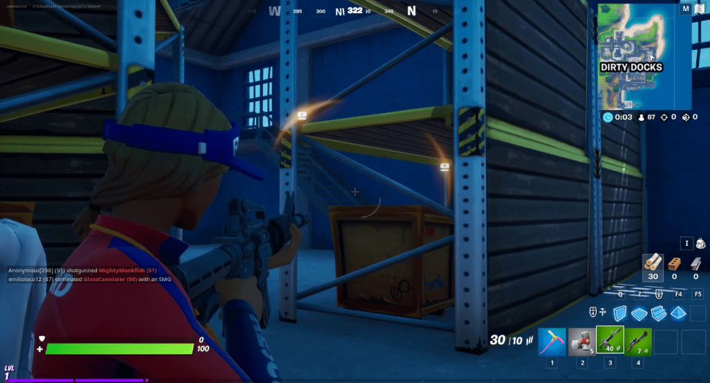 Fortnite, two yellow directional indicators with a treasure chest icon, showing a chest to the upper left and mid right.